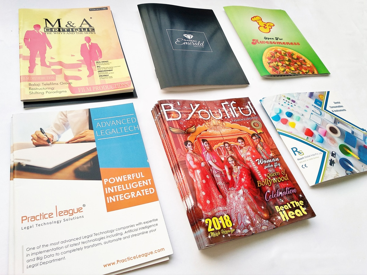 stack of magazines and brochures printed on a four color digital press