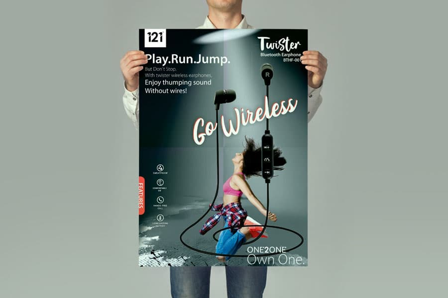 man holding up a digitally printed advertisement poster on paper