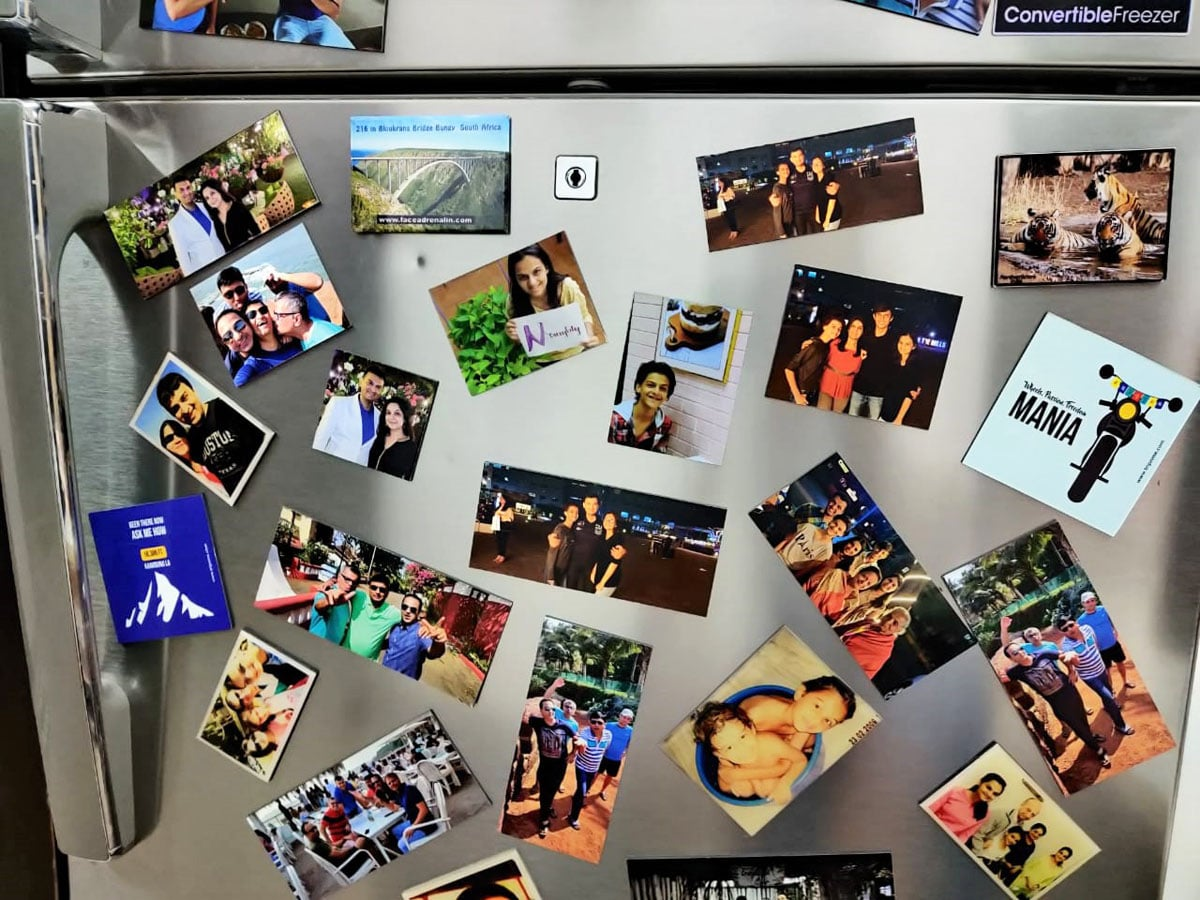 personalised fridge magnets showing images of loved ones pasted on the door of a refrigerator make for a wonderful gift